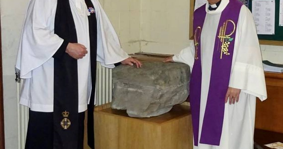 Padre Andrew Totten and Dean Hull with the stone at Down Cathedral.